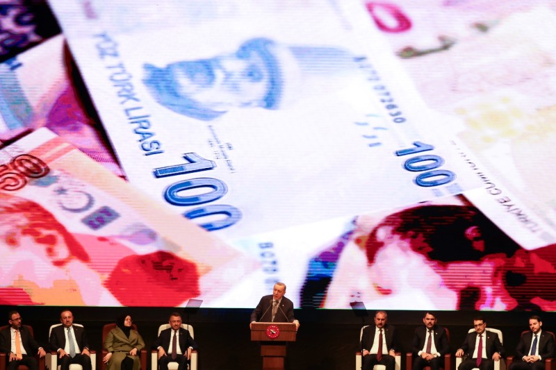 Turkish President Recep Tayyip Erdogan delivers a speech against a background of banknote during the Annual Evaluation Meeting at the Bestepe National Congress and Culture Center in Ankara on Jan. 16.