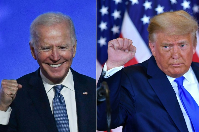 A combination picture shows Democratic presidential nominee Joe Biden in Wilmington, Delaware, and U.S. President Donald Trump in Washington, D.C., early Nov. 4.