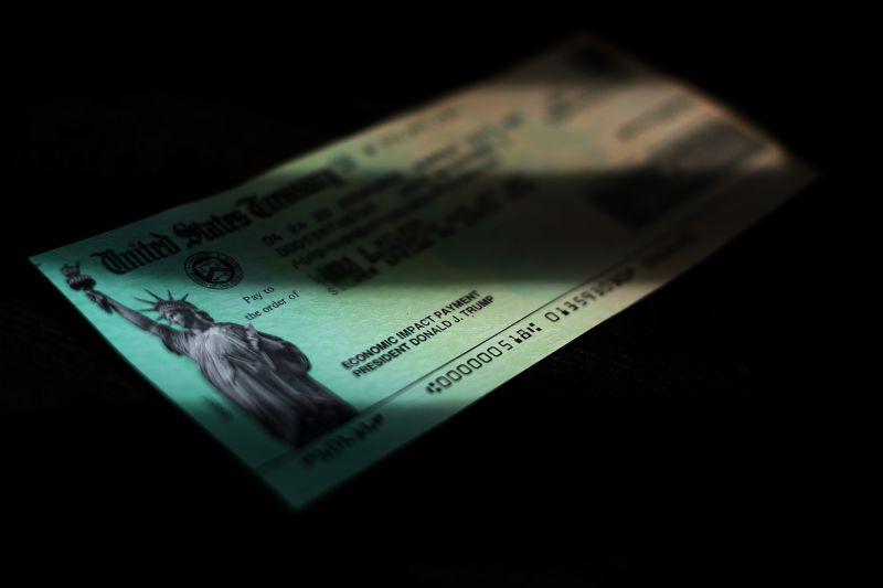 U.S. President Donald Trump's name appears on a coronavirus economic assistance check in Washington, DC on April 29.
