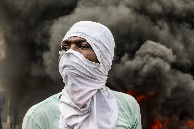Protesters burn tires during a demonstration calling for the departure of Haitian President Jovenel Moïse in Port-au-Prince on Nov. 18. VALERIE BAERISWYL/AFP via Getty Images
