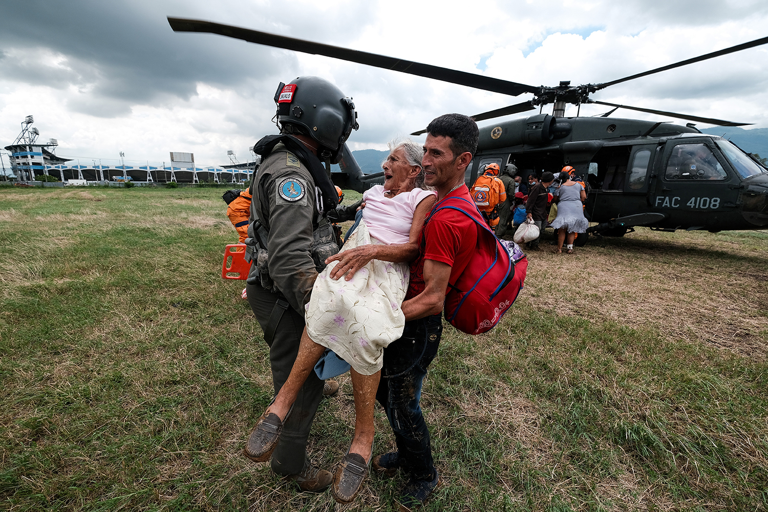 A woman rescued from floods is helped off a helicopter in San Pedro Sula, Honduras, on Nov. 20. After hitting the Colombian islands of Providencia and San Andres, Hurricane Iota made landfall in Haulover, Nicaragua, as a Category 4 storm and then tore through Honduras and El Salvador, causing landslides and floods and destroying trees and houses. Yoseph Amaya/Getty Images