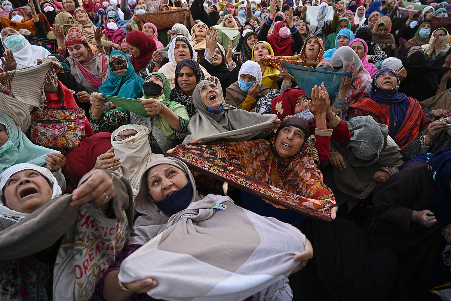 Muslim devotees react as a priest displays a relic believed to be a hair from the beard of Prophet Mohammed during the last Friday of Eid Milad un Nabi, which marks the birth anniversary of the prophet, at the Hazratbal Shrine in Srinagar, an Indian territory in Jammu and Kashmir, on Nov. 6. TAUSEEF MUSTAFA/AFP via Getty Images