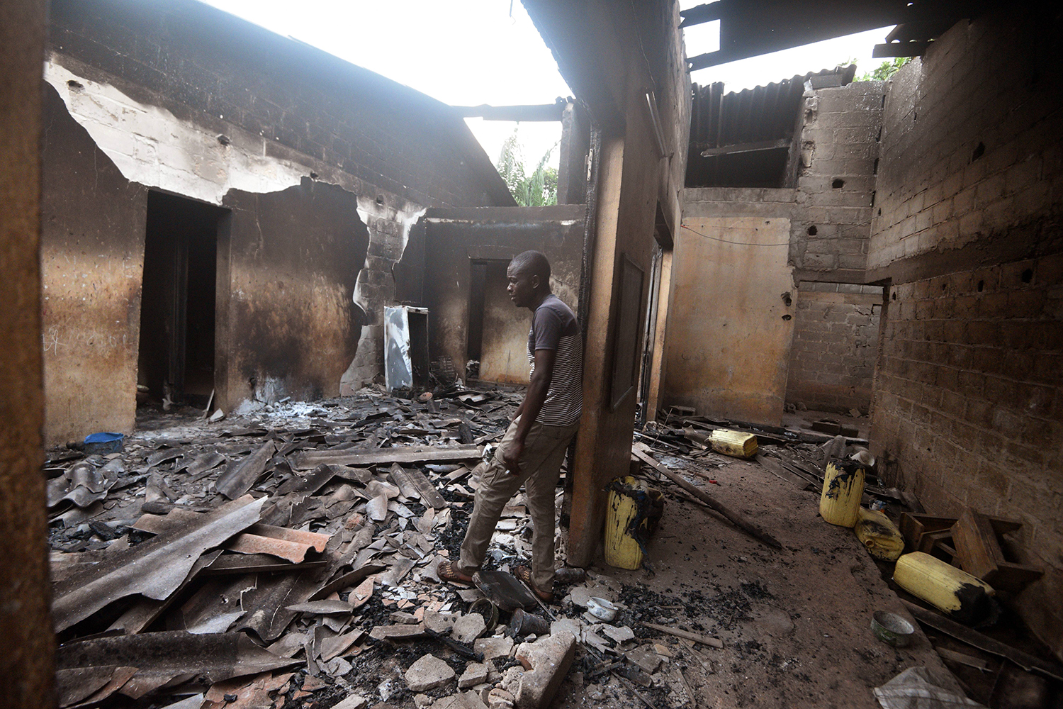 A man cries inside his destroyed house in Toumodi, central Ivory Coast, on Nov. 3 after houses and shops were set ablaze in clashes between neighboring ethnic communities who back rival political factions. SIA KAMBOU/AFP via Getty Images