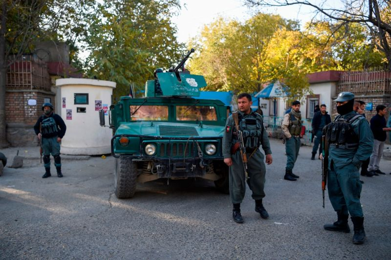 Police guard an entrance to Kabul University the day after an attack by a gunman at the university in Kabul on Nov. 3.