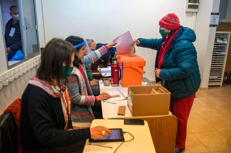 A woman votes at a polling station in Montevideo during municipal and departmental elections in the midst of the COVID-19 pandemic on Sept. 27.