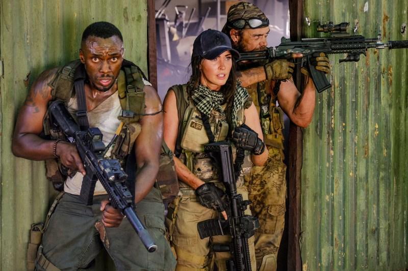 "Sisanda Henna, Megan Fox, and Brandon Auret in ""Rogue."""