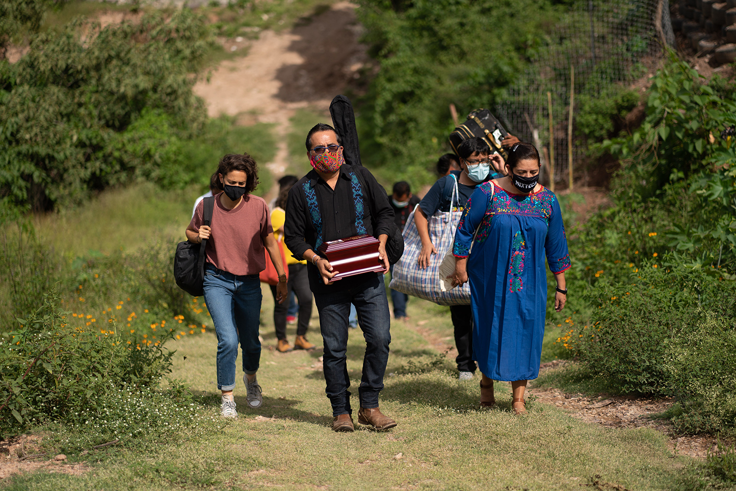 Juan Carlos Ruiz, the pastor of the Lutheran Church of the Good Shepherd, carries Claudio's ashes in Tlapa on Sept. 27. The pastor carried Claudio's remains from New York to Mexico to deliver them to Claudio's family.