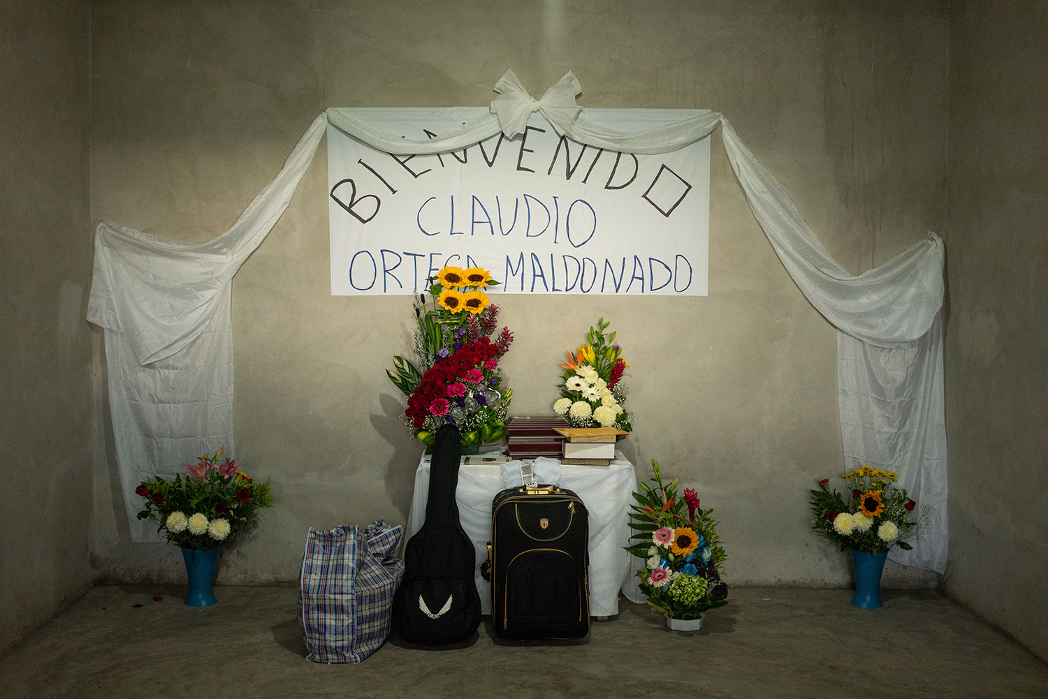 An altar for Claudio features his guitar and suitcase during a service for him in Tlapa on Sept. 27.
