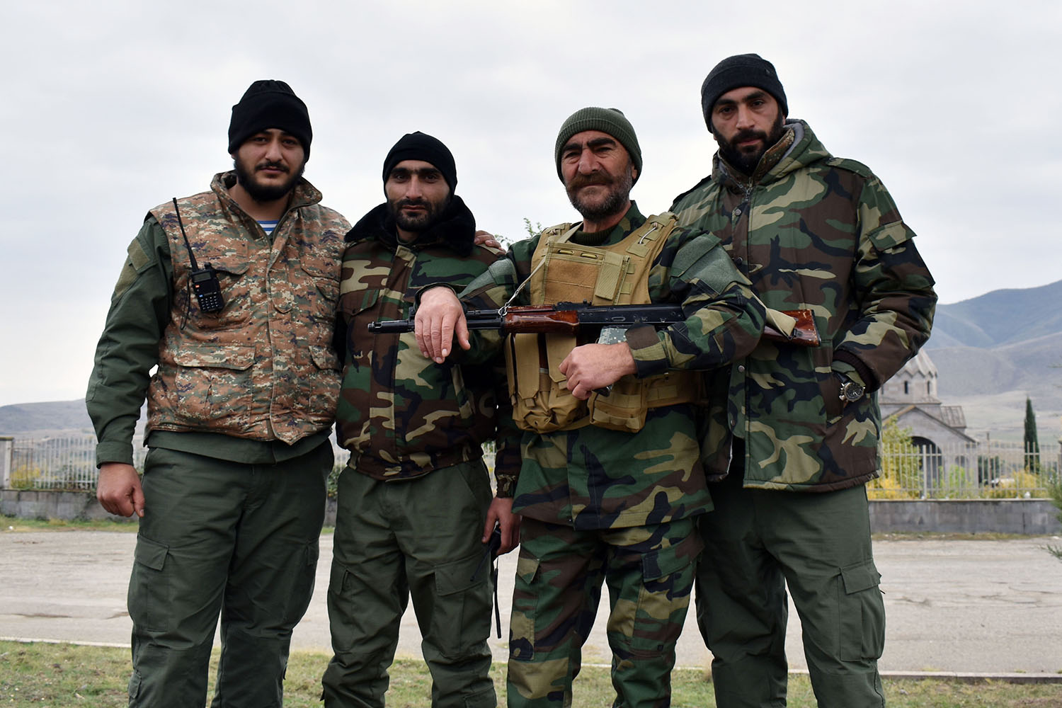 Volunteer fighters pose with well-known rebel fighter Pavel Manukyan (second from right) in the town of Askeran, near what was the front line in Nagorno-Karabakh on Nov. 15.