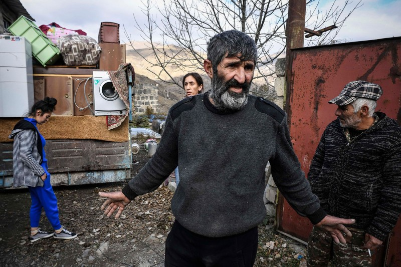 Armenians pack their belongings while leaving their house in the town of Kalbajar, one of the seven districts to be transferred to Azerbaijan as part of a deal on Nagorno-Karabakh, on Nov. 12. ALEXANDER NEMENOV/AFP via Getty Images