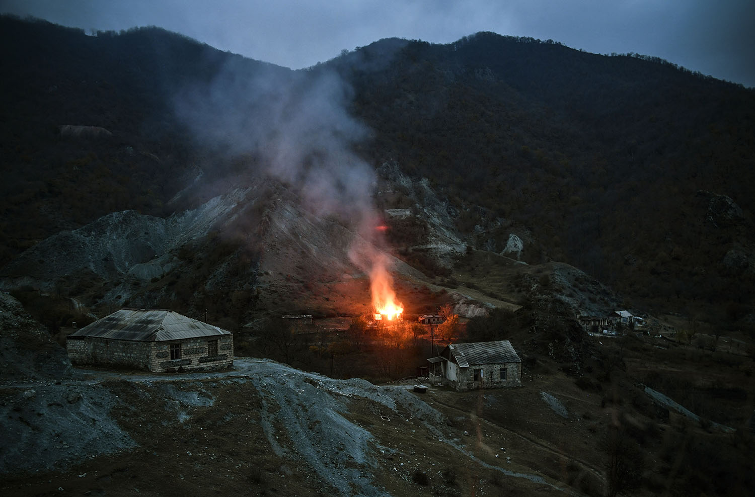 A house burns in a village outside the town of Kalbajar on Nov. 14.