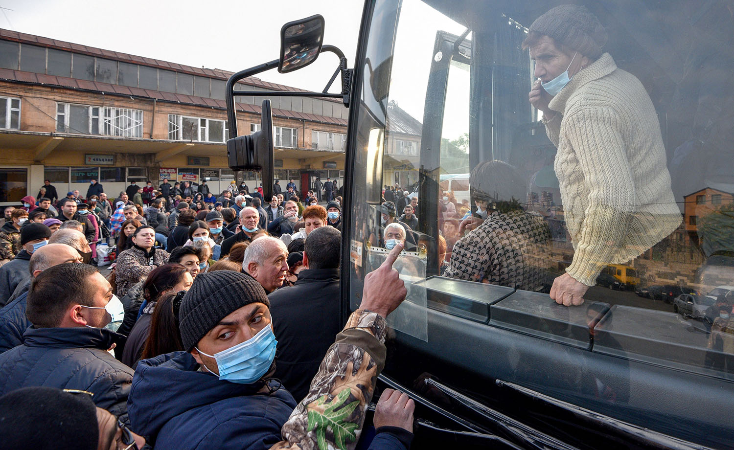 Refugees from the Nagorno-Karabakh region get in a bus in Yerevan, Armenia, heading to Stepanakert, the region's main city, on Nov. 17.