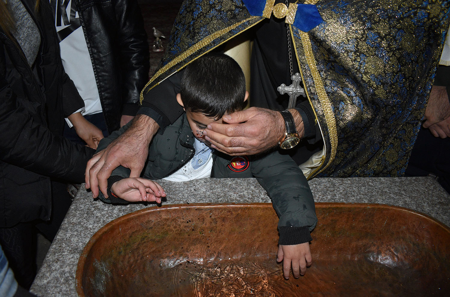 A child is baptized at Nagorno-Karabakh's Dadivank monastery as Russian peacekeepers arrive to oversee the transfer of the nearby province of Kalbajar to Azerbaijan on Nov. 14.