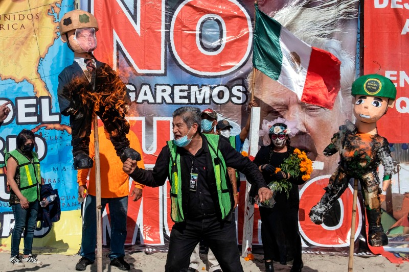 An anti-Trump demonstrator cheers in Mexico