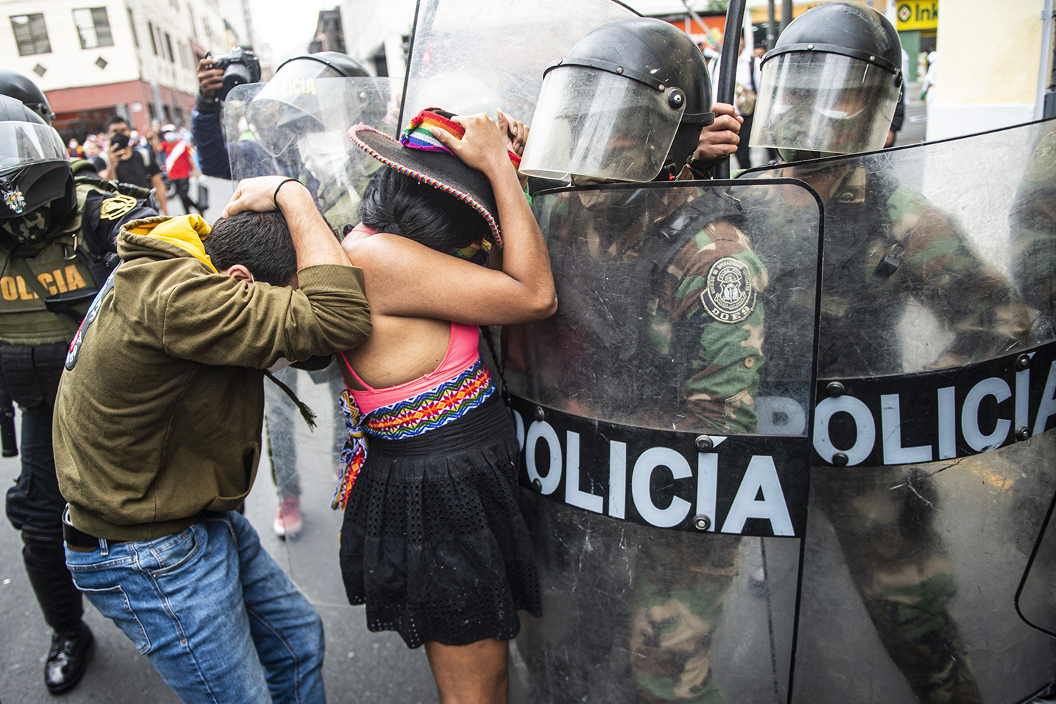 Supporters of ousted Peruvian President Martín Vizcarra, who was removed in an impeachment vote, demonstrate against the new government in Lima, Peru, on Nov. 10. ERNESTO BENAVIDES/AFP via Getty Images