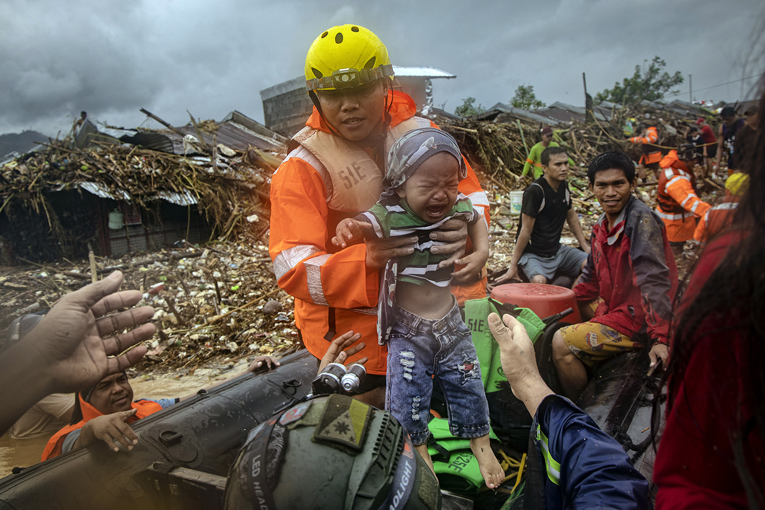 A rescuer carries a baby as floodwaters continue to rise in the submerged village of Rodriguez, Philippines, on Nov. 12 after the passage of Typhoon Vamco. The storm, equivalent to a Category 4 hurricane, battered the Philippines, causing widespread flooding and destruction in areas still reeling from the effects of Super Typhoon Goni. Ezra Acayan/Getty Images