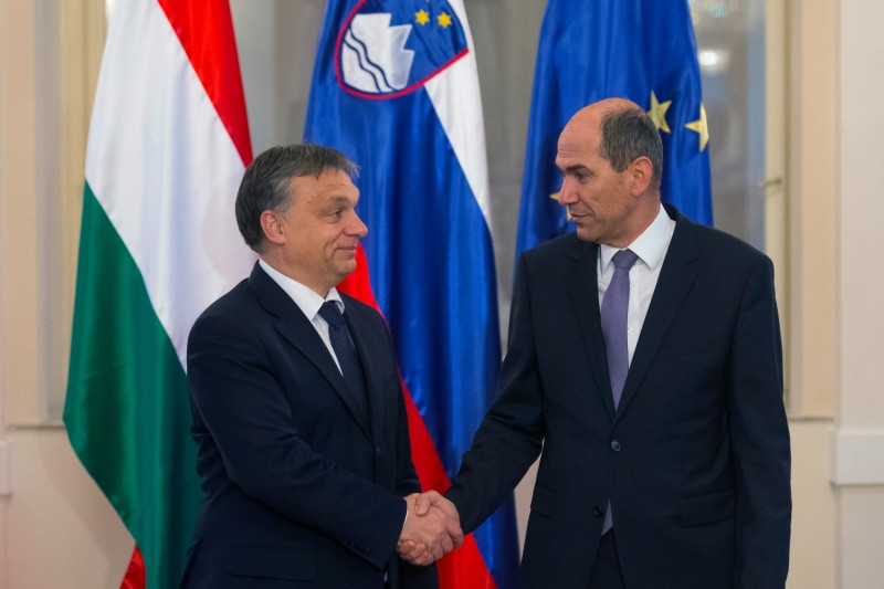 Slovenian Prime Minister Janez Jansa (right) shakes hands with his Hungarian counterpart, Viktor Orban, prior to their meeting in Ljubljana, Slovenia, on Nov. 26, 2012.
