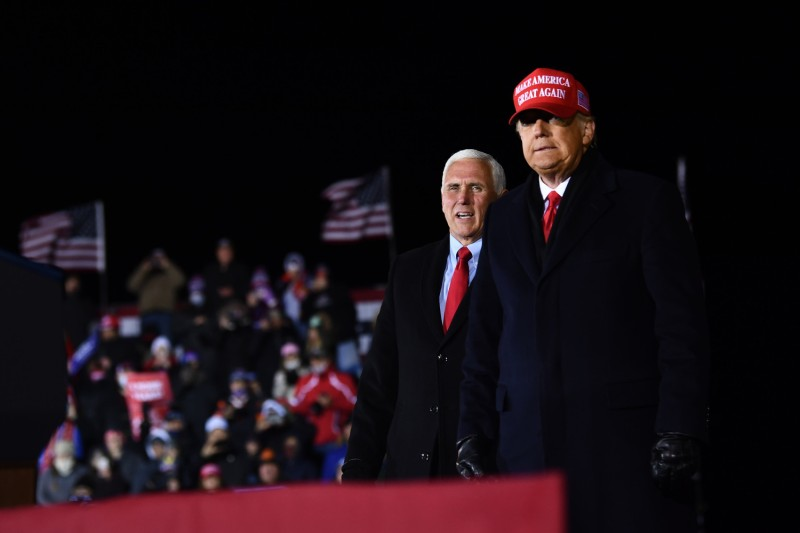 U.S. President Donald Trump stands on stage with Vice President Mike Pence
