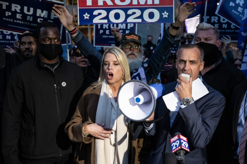 Corey Lewandowski, former campaign advisor to U.S. President Donald Trump (right), and former Florida Attorney General Pam Bondi speak to the media about a court order giving the Trump campaign access to observe vote counting operations in Philadelphia, Pennsylvania, on Nov. 5.