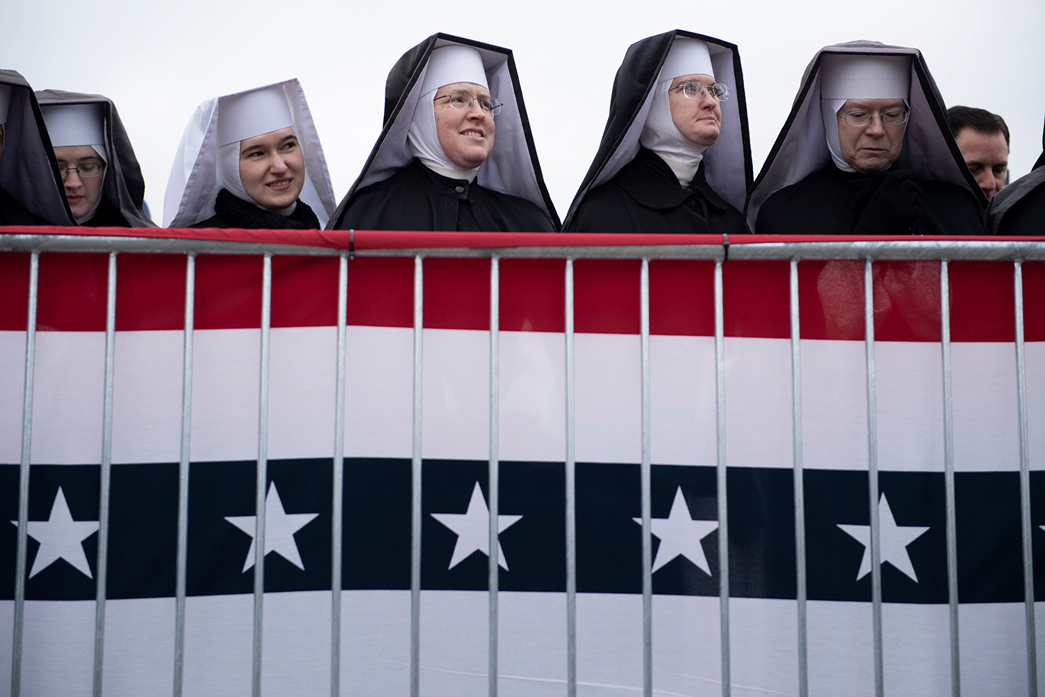 Little Sisters of the Poor wait for U.S. President Donald Trump to speak during a rally at Total Sports Park in Washington, Michigan, on Nov. 1. BRENDAN SMIALOWSKI/AFP via Getty Images