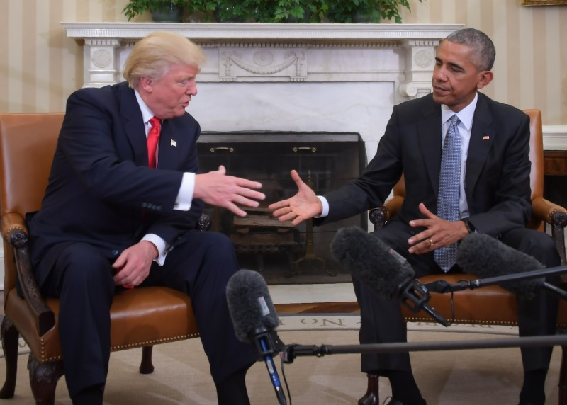 Former President Barack Obama and Republican President-elect Donald Trump shake hands during a transition planning meeting in the Oval Office at the White House on November 10, 2016 in Washington,DC. (Jim Watson/AFP/Getty Images)