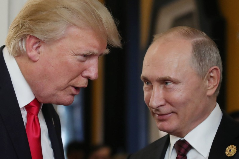 U.S. President Donald Trump chats with Russia's President Vladimir Putin