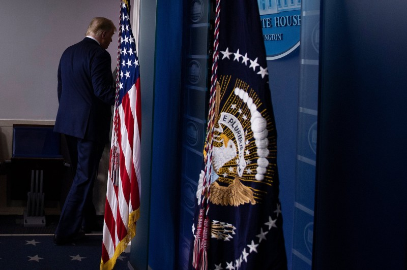 U.S. President Donald Trump leaves after addressing the press at the White House in Washington on Nov. 5.