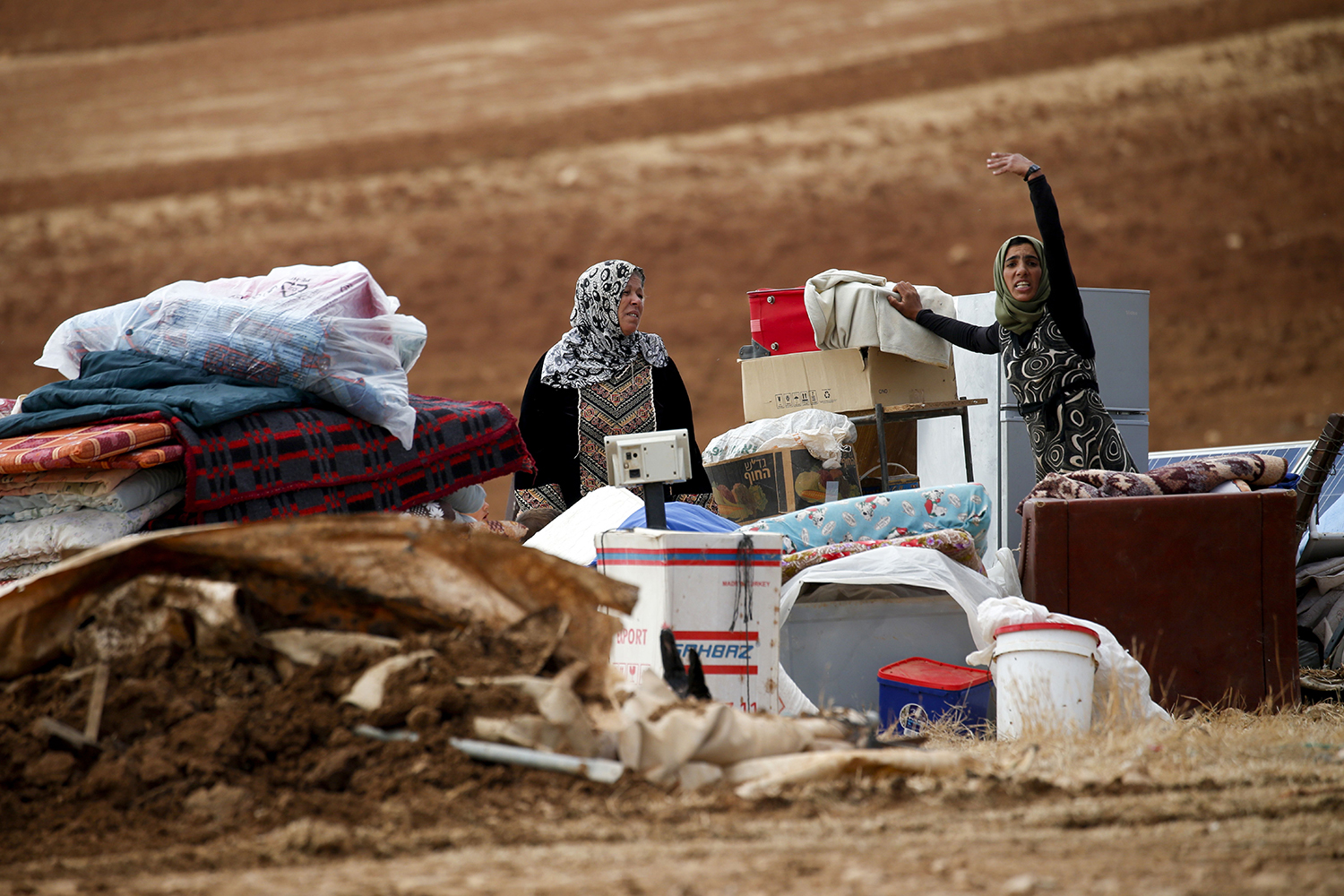 Palestinian Bedouins stand next to their belongings after Israeli soldiers demolished their tents in an area east of the village of Tubas, in the occupied West Bank, on Nov. 3. JAAFAR ASHTIYEH/AFP via Getty Images