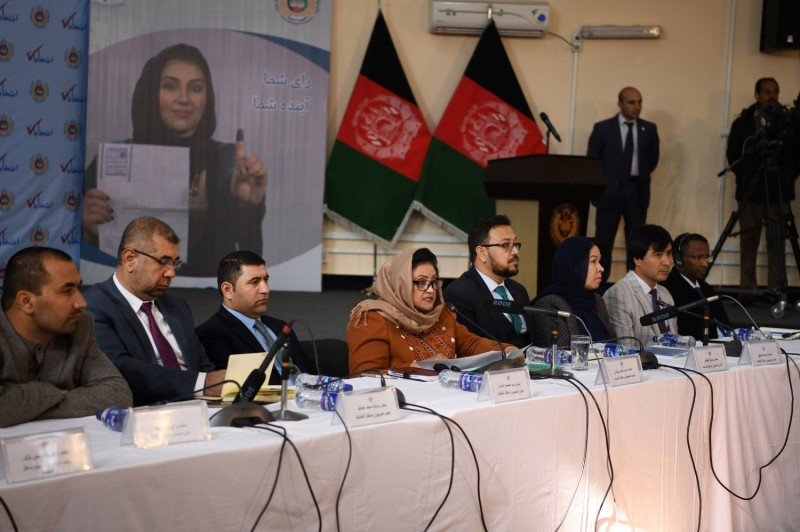 Hawa Alam Nuristani (center), the head of the Afghan Independent Electoral Commission, announces the preliminary results of the 2019 Afghan presidential election in Kabul on Dec. 22, 2019. Incumbent President Ashraf Ghani won a second term.