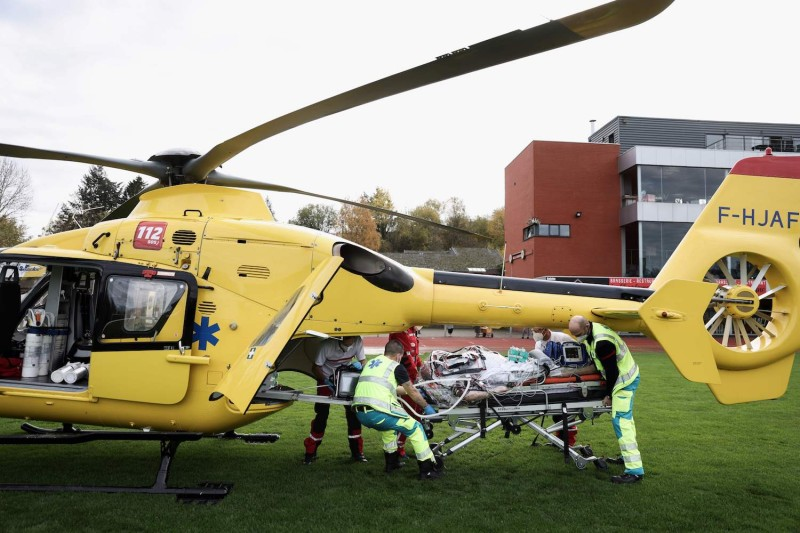 Medics ready to load a patient infected with COVID-19 into a waiting helicopter to be transfered from Verviers hospital to Antwerp, on November 9, 2020.
