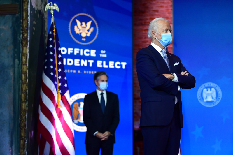 U.S. President-elect Joe Biden and his planned nominee for secretary of state, Antony Blinken, look on during an event introducing key foreign-policy and national security members of the incoming Biden-Harris administration in Wilmington, Delaware, on Nov. 24.