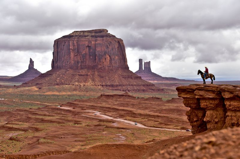 A Navajo man on a horse poses for tourists in Monument Valley Navajo Tribal Park, Utah, on May 16, 2015.