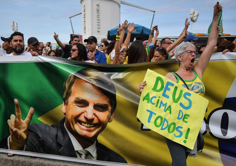 "Supporters of then presidential candidate Jair Bolsonaro gather at Copacabana beach during a ""Women for Bolsonaro"" demonstration in Rio de Janeiro on Sept. 29, 2018."