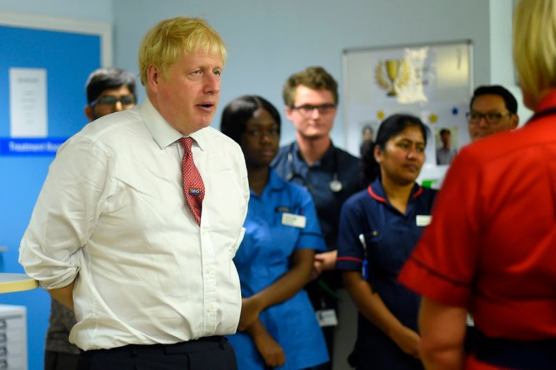 British Prime Minister Boris Johnson speaks to nurses as he visits Watford General Hospital on Oct. 7, 2019 in Watford, England.