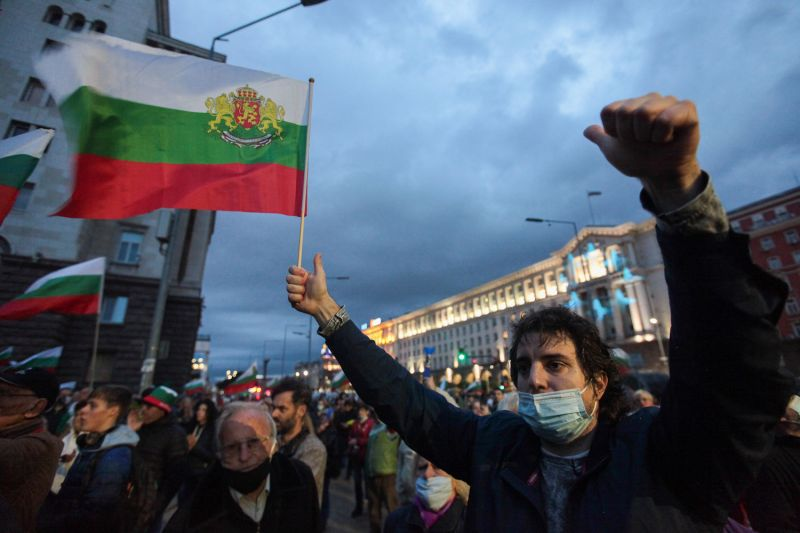 People wave Bulgarian flags during an anti-government protest near the parliament building in Sofia on Oct. 16.