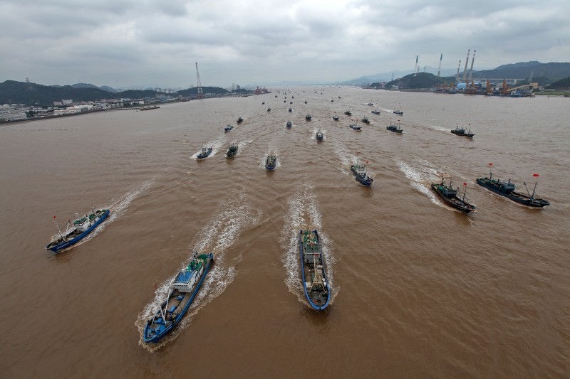 Chinese fishing boats set off after being moored for more than three months in Taizhou, China, due to the annual fishing ban on the East China Sea on Sept. 16, 2014.