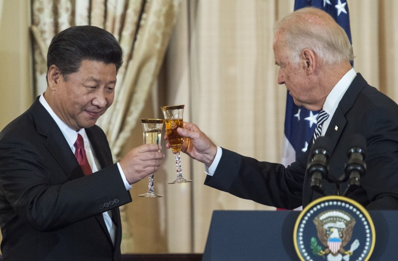 Then-U.S. Vice President Joe Biden and Chinese President Xi Jinping toast during a state luncheon for China on Sept. 25, 2015, at the U.S. Department of State in Washington.