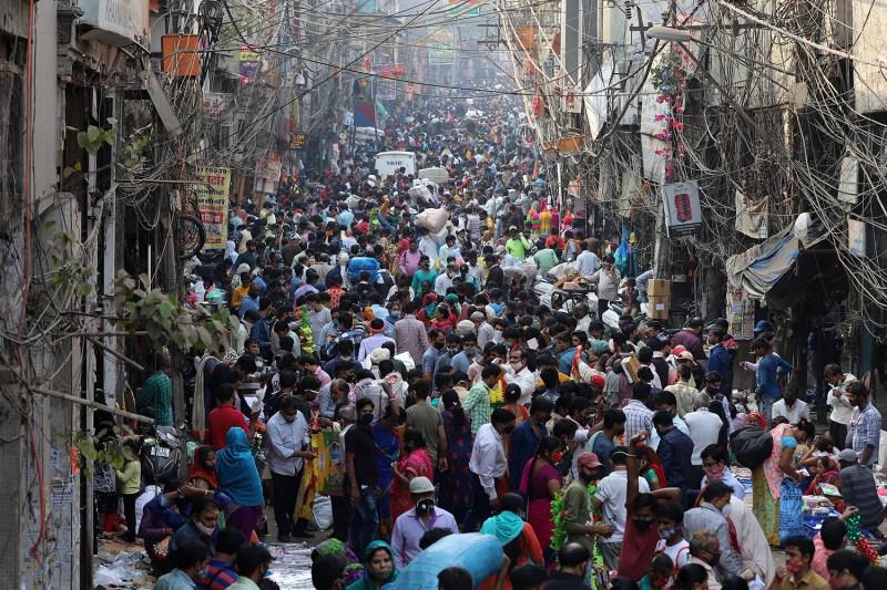 Crowds swarm the Sadar Bazar as people shop during the upcoming Diwali festival in Delhi on Nov. 13.