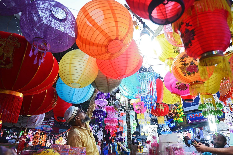 A shopkeeper arranges lanterns at a roadside market ahead of the Hindu festival Diwali, the festival of lights, in Kolkata on Nov. 7.
