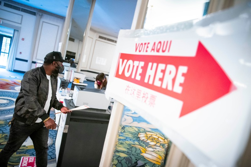 A voter casts his ballot at an early voting center in Washington, DC, on Oct. 27.