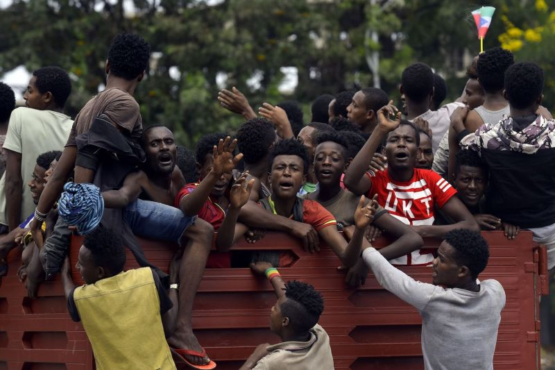 Youth from the Sidama ethnic group, the largest in southern Ethiopia, ride in the back of a truck during celebrations over plans by local elders to declare the establishment of a breakaway region for the Sidama later this week, in Awasa, Ethiopia on July 15, 2019.