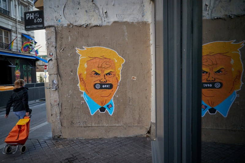 A pedestrian walks past anti-Donald Trump street art in Paris on Oct. 31.
