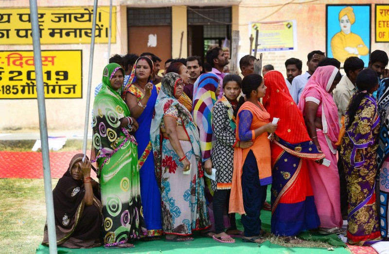 Indian voters line up at a polling station to cast their ballots during the fifth phase of general election in Amethi, Uttar Pradesh, India, on May 6, 2019.