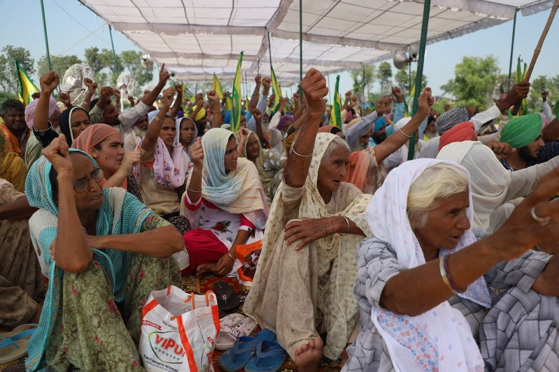 Naseemo Kaur (left) shouts slogans during a protest in the Moag area of Punjab, India, on Oct. 1.