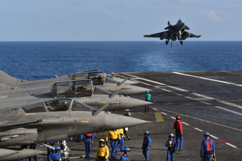 "A French Rafale fighter jet prepares to land on the aircraft carrier ""Charles de Gaulle"" during a joint Indo-French naval exercise off Goa, India, on May 9, 2019."