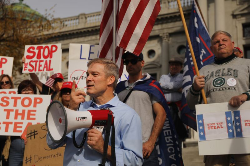 Representative Jim Jordan (R-Ohio) stands with dozens of people calling for stopping the vote count in Pennsylvania due to unfounded charges of fraud on the steps of the State Capitol on Nov. 5 in Harrisburg, Pennsylvania.