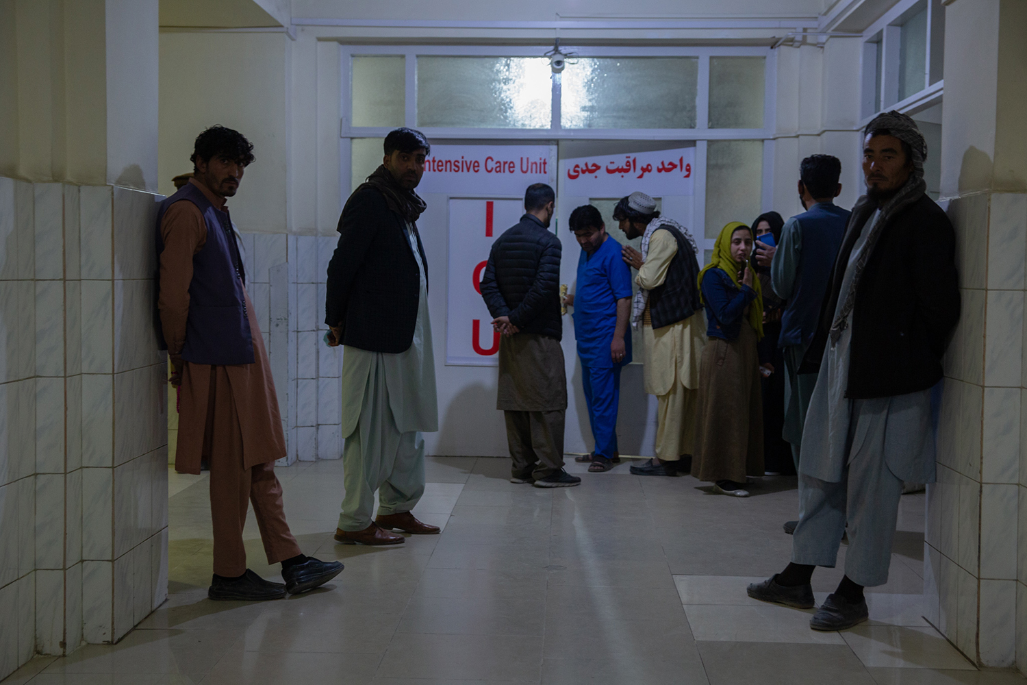 Family members of students injured in the Kabul University attack wait outside the intensive care unit at Ali Abed hospital, a clinic right opposite the university, on Nov. 2.