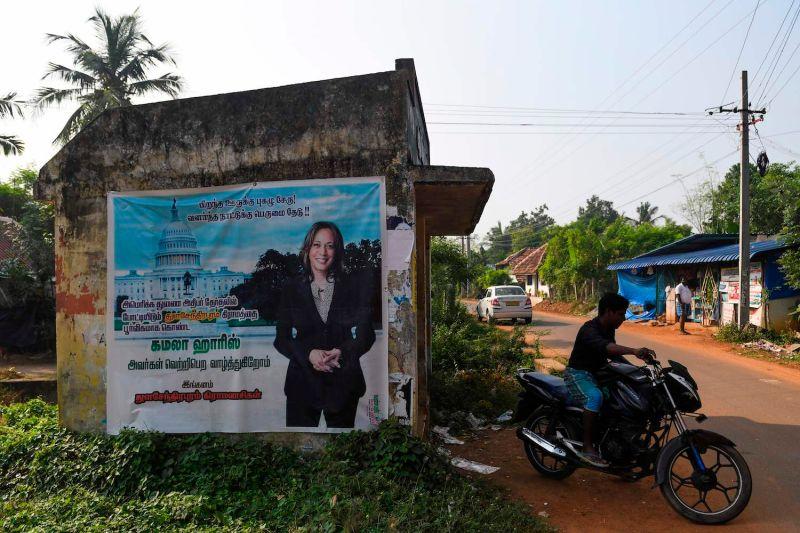 A motorist rides past a poster of U.S. Democratic vice presidential candidate Kamala Harris at her ancestral village of Thulasendrapuram, Tamil Nadu, India, on Nov. 3.