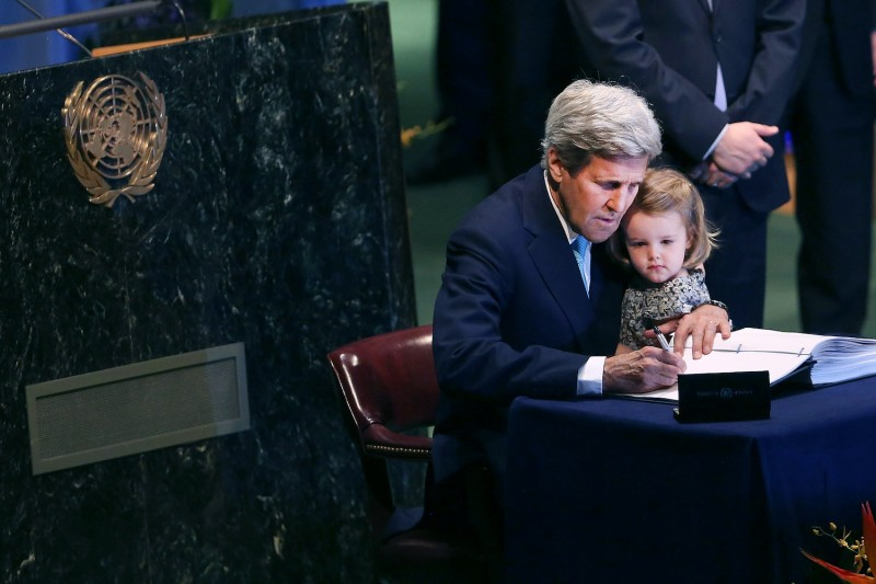 U.S. Secretary of State John Kerry holds his granddaughter for the signing of the accord at the United Nations Signing Ceremony for the Paris Agreement  climate change accord that came out of negotiations at the COP21 climate summit last December in Paris. on April 22, 2016 in New York City.