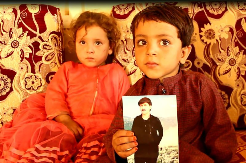 The children of the radio journalist Rahim Sekander display a photo of him in their home in Khost on Oct. 27.